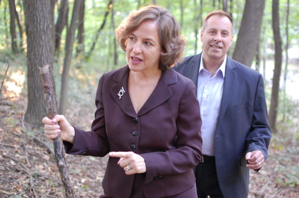 Allison Rimm coaching Manny Correia in the woods